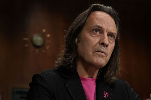 T-Mobile executives repeatedly stayed at Trump hotel while pushing for merger approval