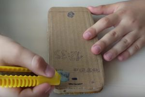 Watch as a young kid performs a durability test on a cardboard Pixel he created