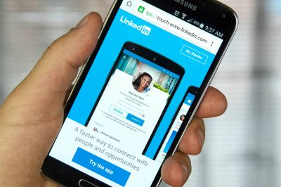 LinkedIn's app can record and share video, not that you would