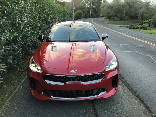 The Kia Stinger is one of the best cars I've driven all year - here's how it matches up against its competition from BMW