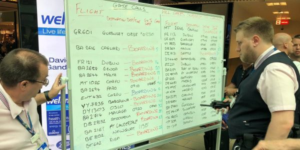 Flight information at the UK's 2nd-largest airport is being displayed on whiteboards because all the screens broke