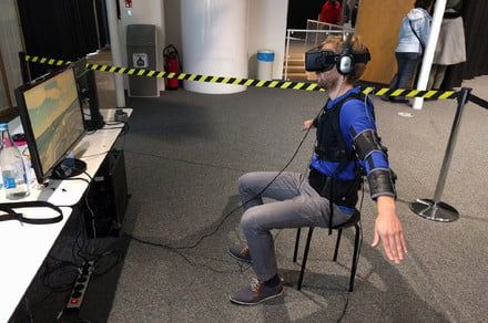 A sensor-packed exosuit lets you fly a drone by pretending to be one