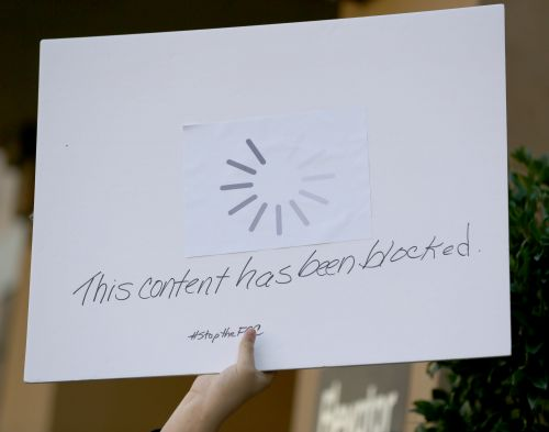 Net neutrality battle: Bicyclist slows real traffic in protest; California bill advances