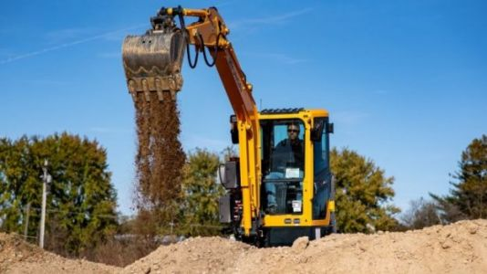 This Compact Electric Backhoe Cuts Construction Noise