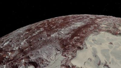 NASA Unveils New Maps of Pluto, Moon Charon for Flyby Anniversary