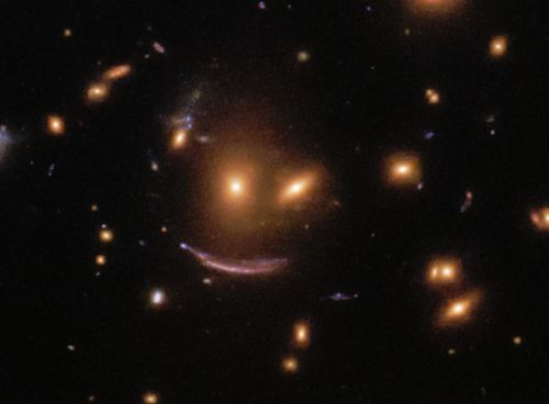 Hubble captured an image of a face in space and I can't tell if it's cool or creepy