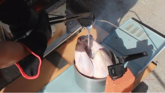 Watch This Guy Cook A Turkey With Molten Aluminum And Then Eat It