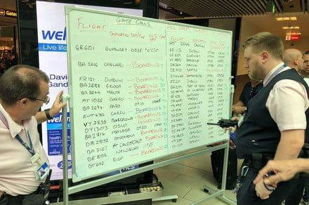 Airport's low-tech solution to digital chaos involves the humble whiteboard