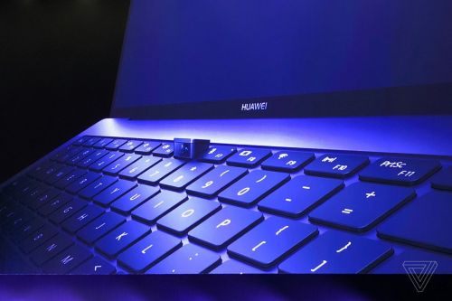 Huawei's new laptop has a kickass pop-up webcam in the keyboard
