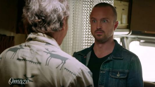 Things Get Wonderfully Weird When Aaron Paul Finds Bryan Cranston Living in the BREAKING BAD RV in This Reunion Video