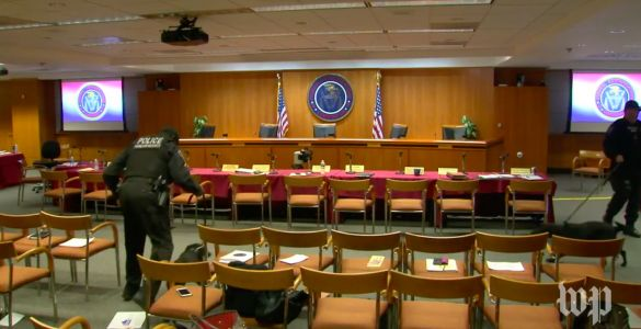 The FCC net neutrality hearing was briefly evacuated and police dogs searched the room 'on advice of security'